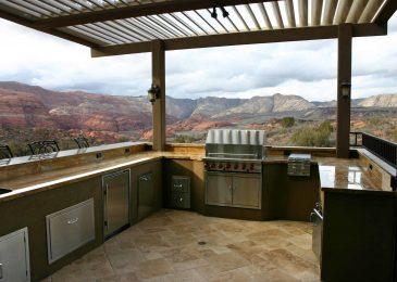 Custom outdoor kitchen with overhead louvers and a magnificent view of a southern Utah canyon