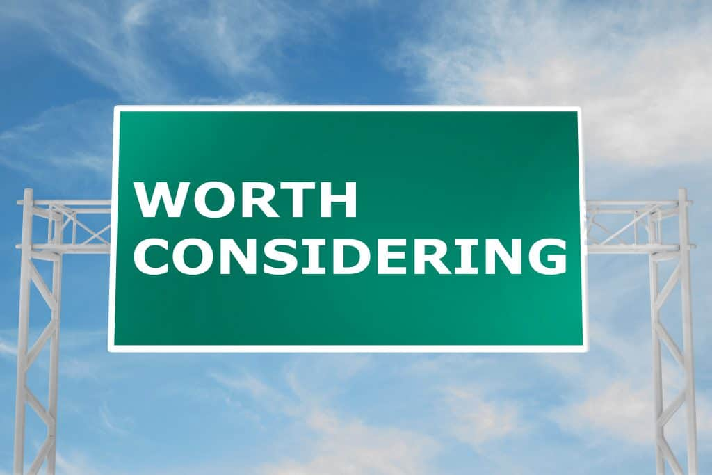 highway road sign that says worth considering