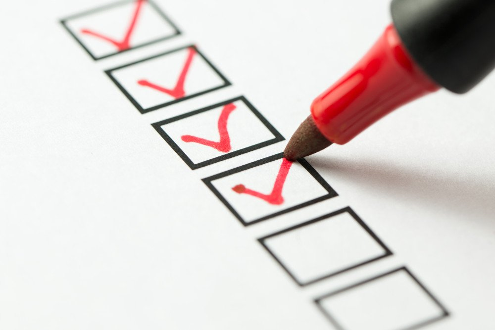 red pen checking boxes for tips about refreshing your bathroom