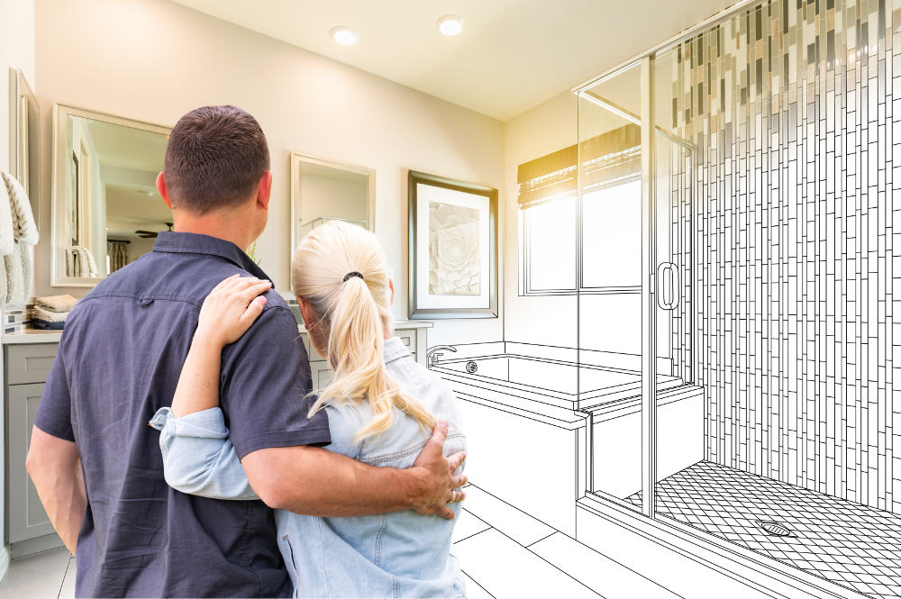 Couple viewing bathroom drawing of remodel for two