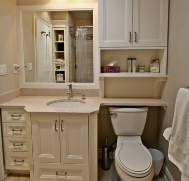small bathroom with over the toilet storage space for organization